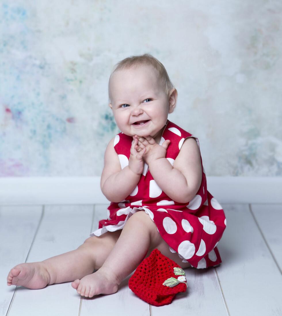 GLEDESSPREDER: - Jeg må smile hver gang jeg ser på dette bildet, sier Natalia. Foto: Fotograf Natalia Pipkina