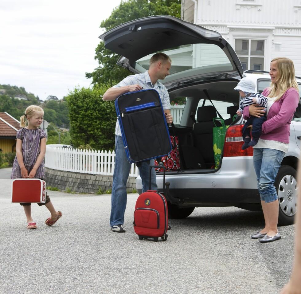 <strong>KLAR FOR BILFERIEN:</strong> Mye skal med når barnefamilien skal på tur. Foto: Berit Roald / NTB Scanpix