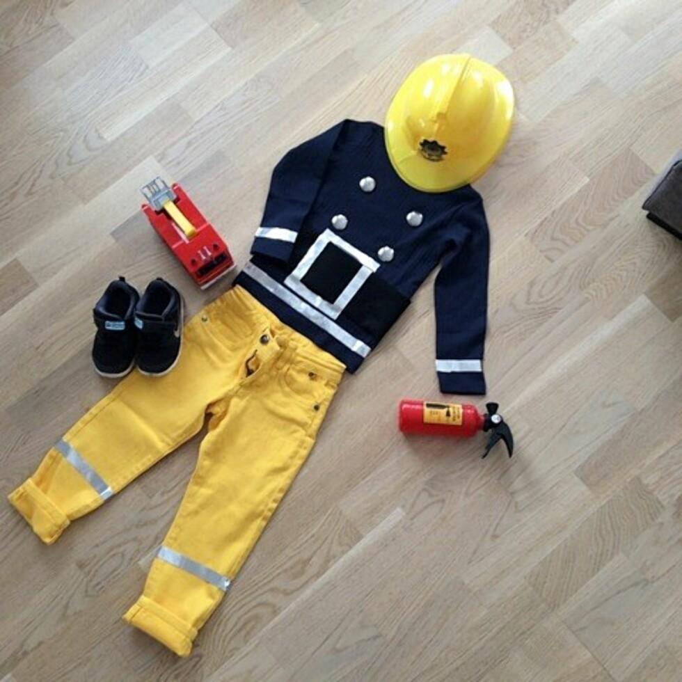 BRANNMANN SAM: Kostymet er laget av vanlige plagg som kan brukes igjen. Foto: Privat