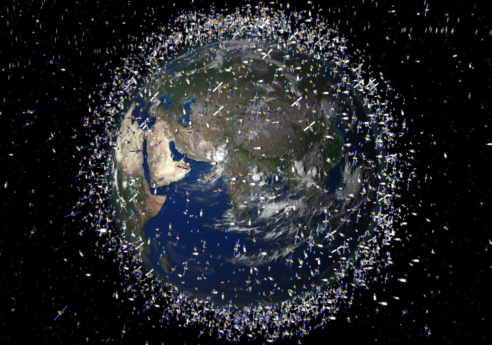 """A computer-generated artists impression released by the European Space Agency (ESA) depicts an approximation of 12 000 objects in orbit around the Earth. A communications satellite belonging to US company Iridium has collided with a disused Russian military satellite, on February 12, 2009. """"A collision has occurred between an Iridium 33 satellite and a Russian Kosmos 2251 military satellite,"""" Russian officials have said. Space News have reported that NASA is tracking hundreds of particles of debris from the collision, and said the orbiting International Space Station faced a small risk of being struck. AFP PHOTO / ESA / HO ---RESTRICTED TO EDITORIAL USE---"""