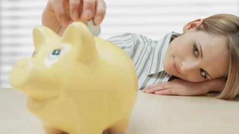 FULL SPAREGRIS: OBS! Denne grisen mottar også sedler! Foto: Image Source/All Over Press