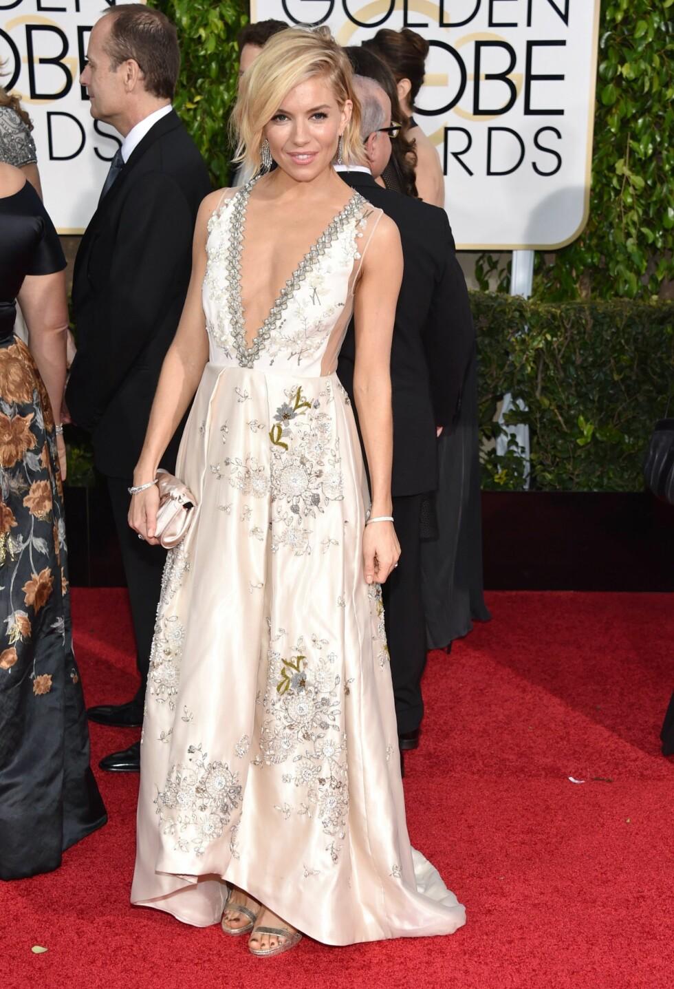 BEST KLEDD: Sienna Miller i 2015 Foto: INVISION