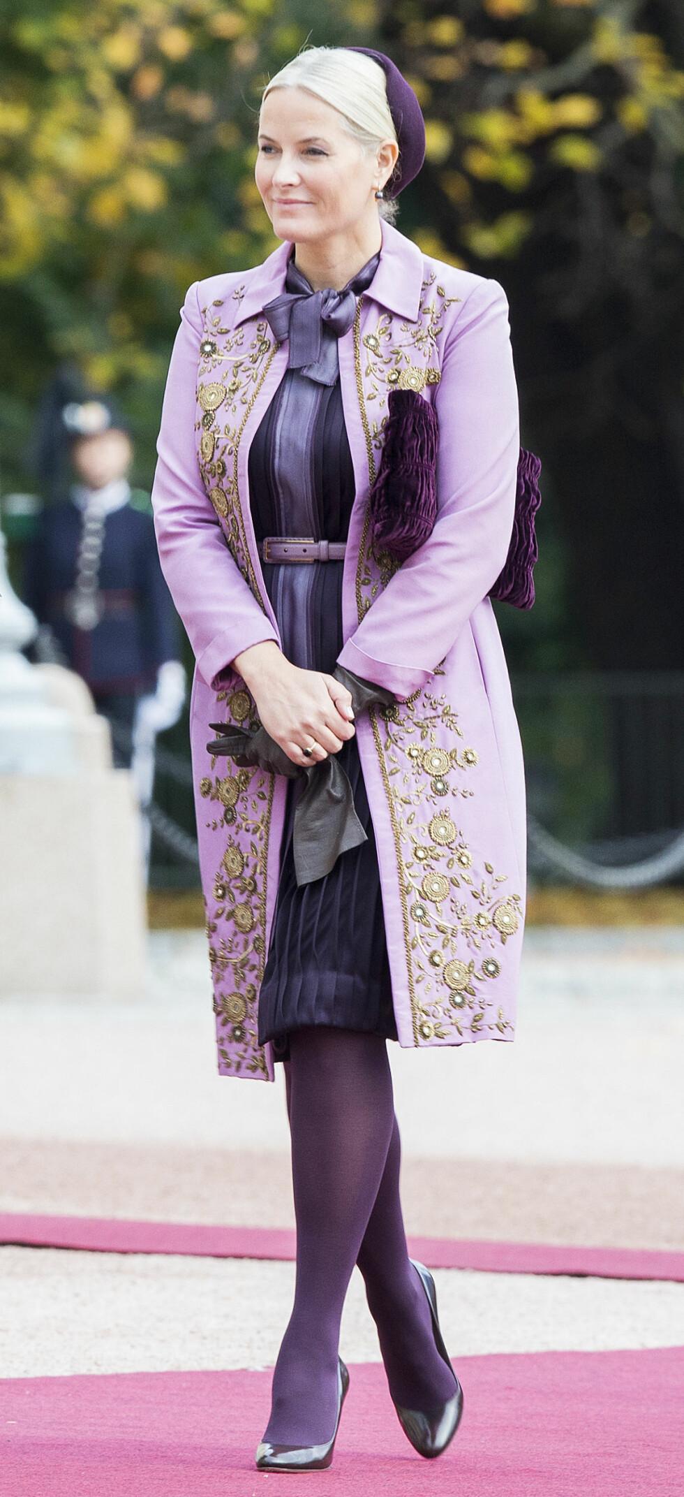 EN LILLA DRØM: Kronprinsesse Mette-Marit fotografert på vei inn på slottet i forbindelse med besøk fra Singapores president Tony Tan Keng Yam og kona Mary Tan. Dette var i oktober. Foto: Berit Roald / NTB scanpix Foto: NTB Scanpix