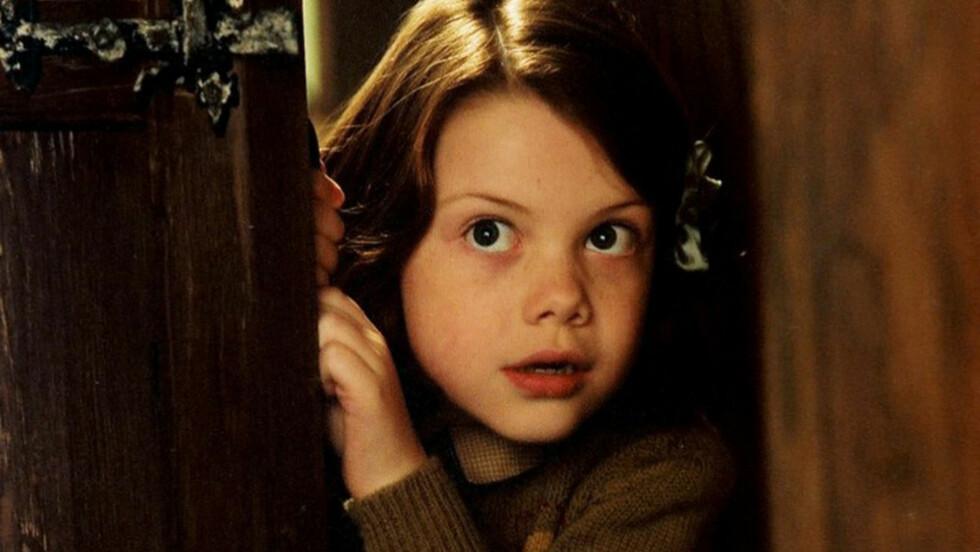 LEGENDEN OM NARNIA: Georgie var bare 10 år gammel da hun spilte Lucy Pevensie for første gang. Her i den første filmen.  Foto: Mary Evans Picture