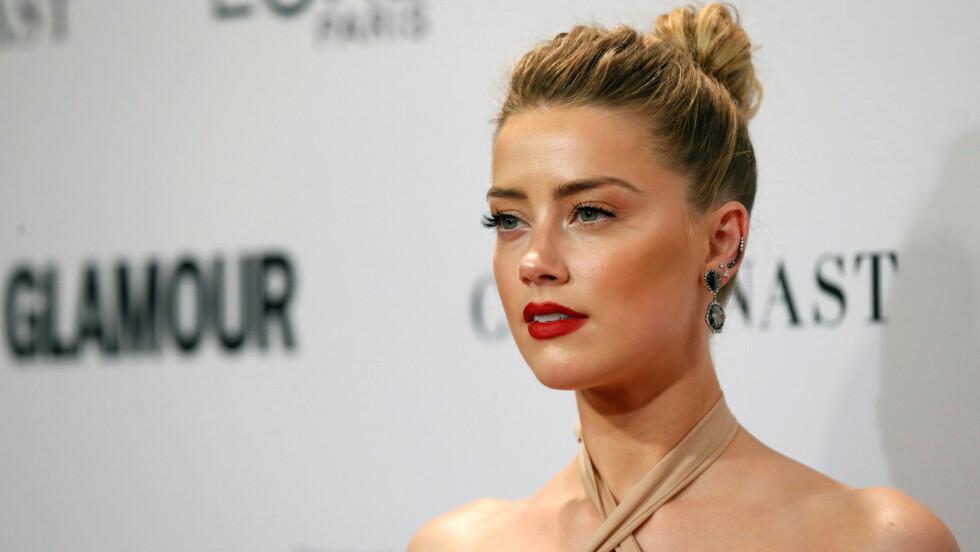 VOLD I HJEMMET: Skuespillerinnen Amber Heard (30) snakker ut om forholdet til Johnny Depp (53) og volden i hjemmet.  Foto: Reuters
