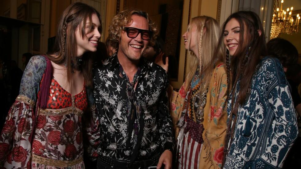 PETER DUNDAS: Mannen i midten er ikke bare designer for Roberto Cavalli - han er også norsk! Foto: Rex Features