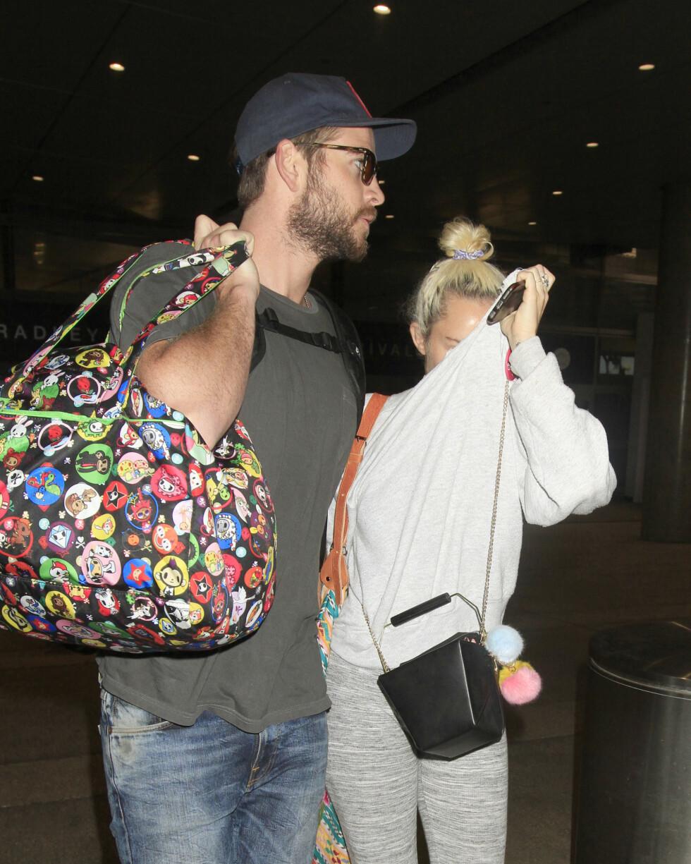 SAMMEN IGJEN: Liam Hemsworth og Miley Cyrus endte forlovelsen sin noen år tilbake. Nå ser det ut til at de to har funnet tilbake til hverandre, men Miley vil fremdeles ikke bli tatt bilde av.  Foto: Splash News