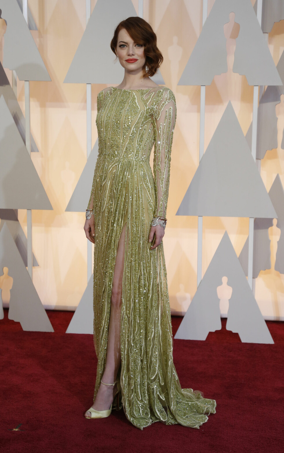 Actress Emma Stone wears a gown by  Elie Saab as she arrives at the 87th Academy Awards in Hollywood, California February 22, 2015.    REUTERS/Mario Anzuoni (UNITED STATES  - Tags: ENTERTAINMENT)   (OSCARS-ARRIVALS)  Foto: Reuters