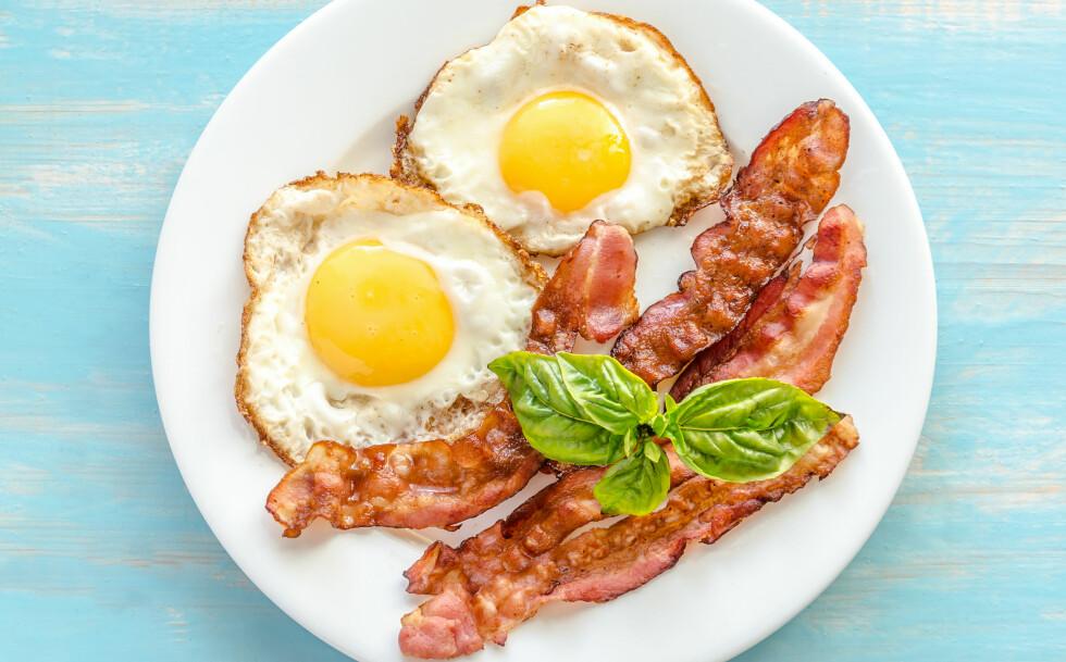IKKE FARLIG, MEN: Ekspertene forteller at bacon ikke nødvendigvis er farlig, men de anbefaler heller ikke et høyt daglig inntak. Foto: Shutterstock / alexpro9500