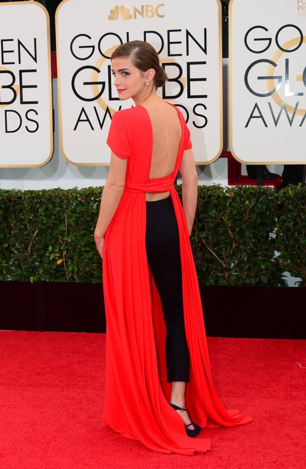TOK PÅ SEG DET SAMME: Under Golden Globes i 2014 (avbildet) hadde Emma Watson på seg en kjole over et par bukser. Hun gikk for den samme stilen under middagen i Det Hvite Hus. Foto: Afp