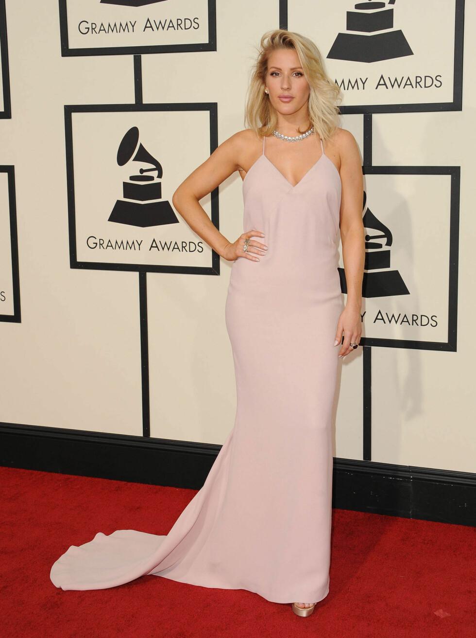 VAKKER: 29-åringen strålte i denne pudderrosa kreasjonen under Grammy Awards. Foto: Pa Photos