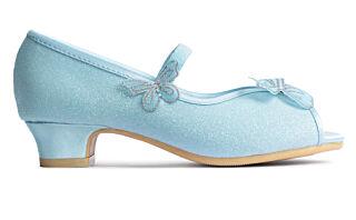 Selger høyhælte sko til 4-åringer