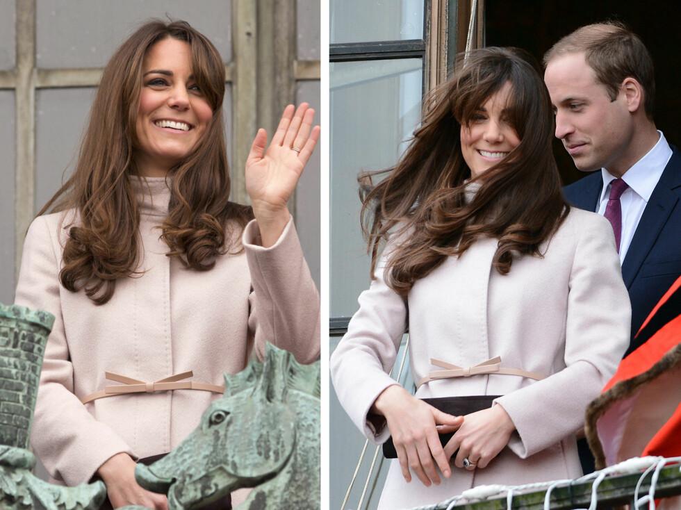 I VINDEN: Kate og ektemannen - prins William, vinker til publikum fra balkongen på Guildhall i Cambridge.  Foto: All Over Press
