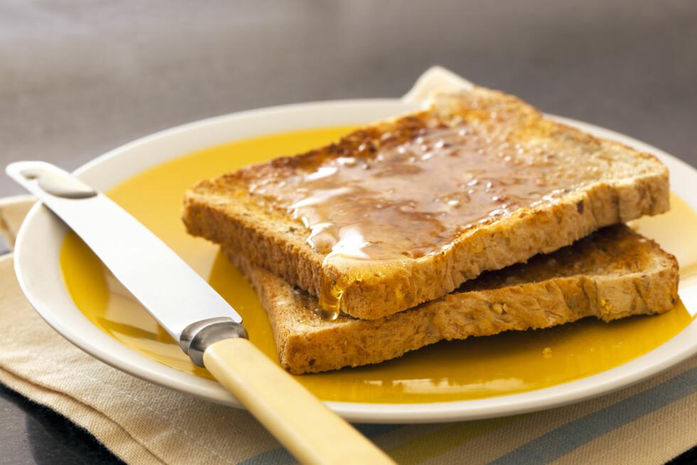 HONNING: - De absolutt mest usunne påleggene vil jeg si er sirup og honning – dette er kun sukker, sier ernæringsekspert Lise von Krogh til KK.no.  Foto: robynmac - Fotolia