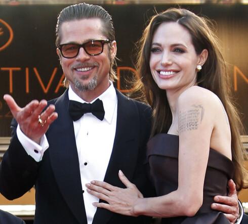 BILLY BOB ER BORTE: Angelina har erstattet Billy Bob-tatoveringen med fødselsdatoen til sine barn.  Foto: Reuters
