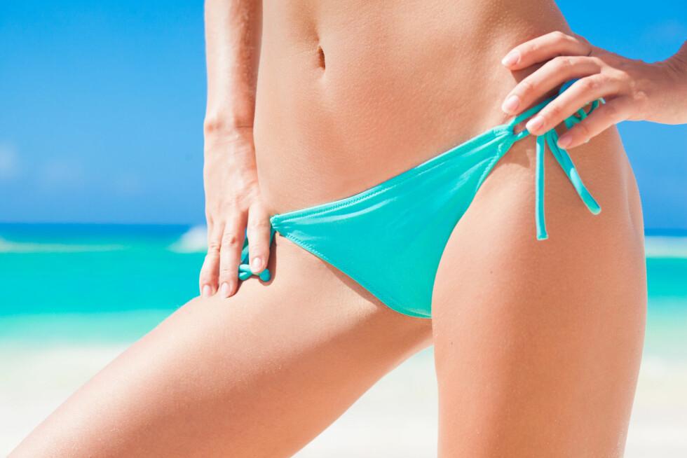 INTIMBARBERING: Nå som bikinisesongen er her er det viktig å være nøye med intimbarberingen slik at du ikke tropper opp på stranden med kviselignende nupper langs bikinilinjen.  Foto: el.rudakova - Fotolia