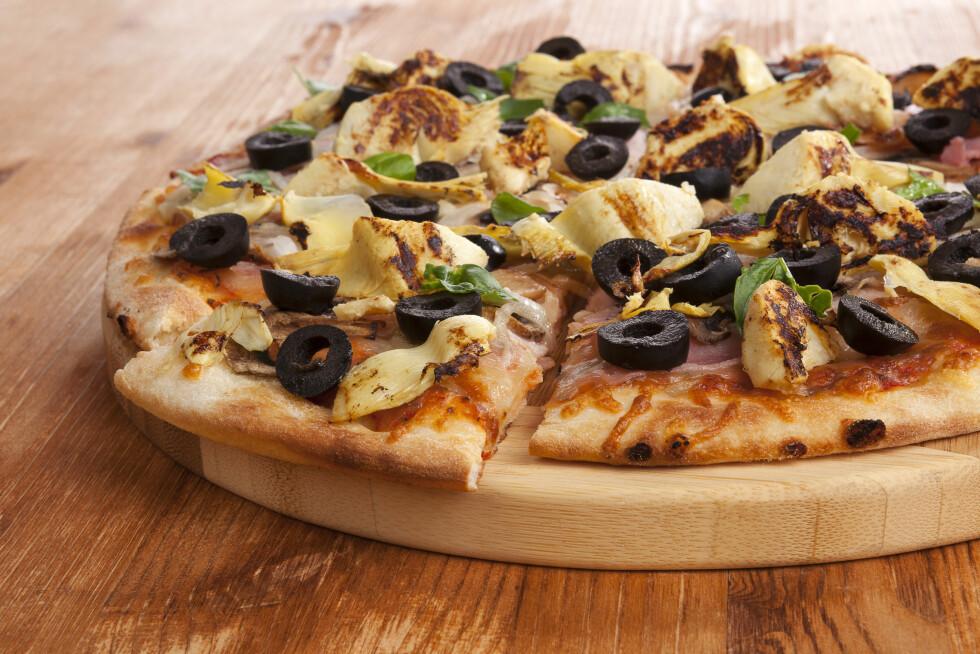 KLASSIKER: Ekte italiensk pizza har gjerne artisjokk som ingrediens. Foto: Eskymaks - Fotolia