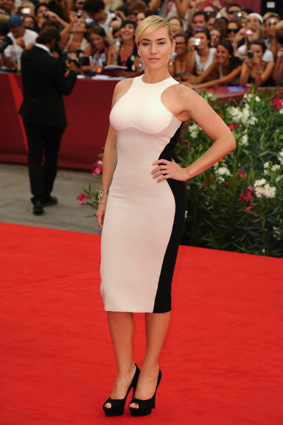 KJOLEPERFEKSJON: Kate Winslet var et syn i denne kjolen fra Stella McCartney på filmfestivalen i Venezia i 2012. Foto: REX/David Fisher/All Over Press