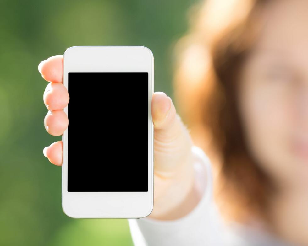 TA DEG EN PAUSE: Dersom du ikke klarer å sitte i ro uten å ta opp mobilen for å spille, mener eksperten det er på tide at du tar deg en pause fra mobilen og spillene.  Foto: Sunny studio - Fotolia
