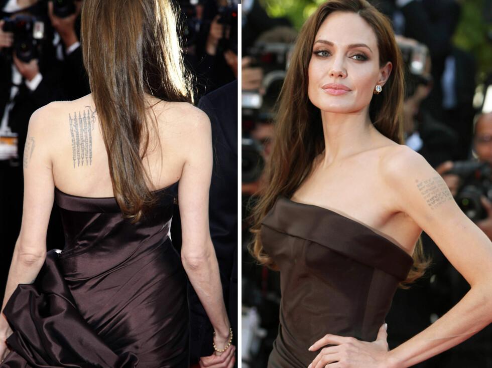 """TRENDY """"INK"""": Tatoveringer har blusset veldig opp igjen i popularitet de siste årene. Angelina Jolie er blant superstjernene som har en stor forkjærlighet for kroppskunsten. Men foreløpig har hun ikke kastet seg ut på den nye leppe-trenden... Foto: All Over Press"""