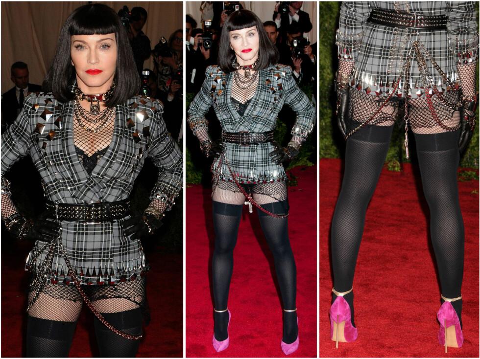 PUNKA: Madonna fulgte definitivt kleskoden til årets Met-galla. Flatterende var det kanskje ikke ... Foto: All Over Press
