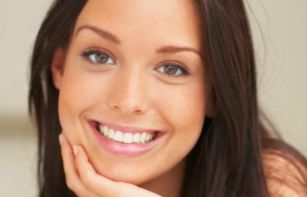 AVSLØRER DEG: Ifølge forskere kan smilet ditt si mye om deg - blant annet om ekteskapet vil vare, hvor fruktbar du er og hvor mye penger du vil tjene.  Foto: Getty Images/Hemera