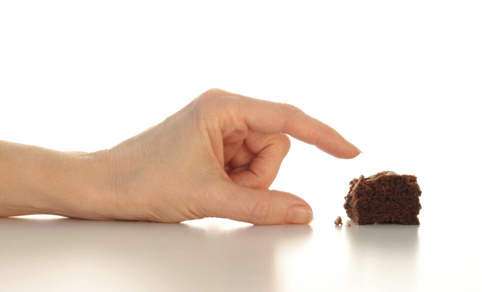 <strong>FRISTET?:</strong> En liiiiten browniebit på kvelden kan vel ikke skade...eller? Foto: Pixsooz - Fotolia