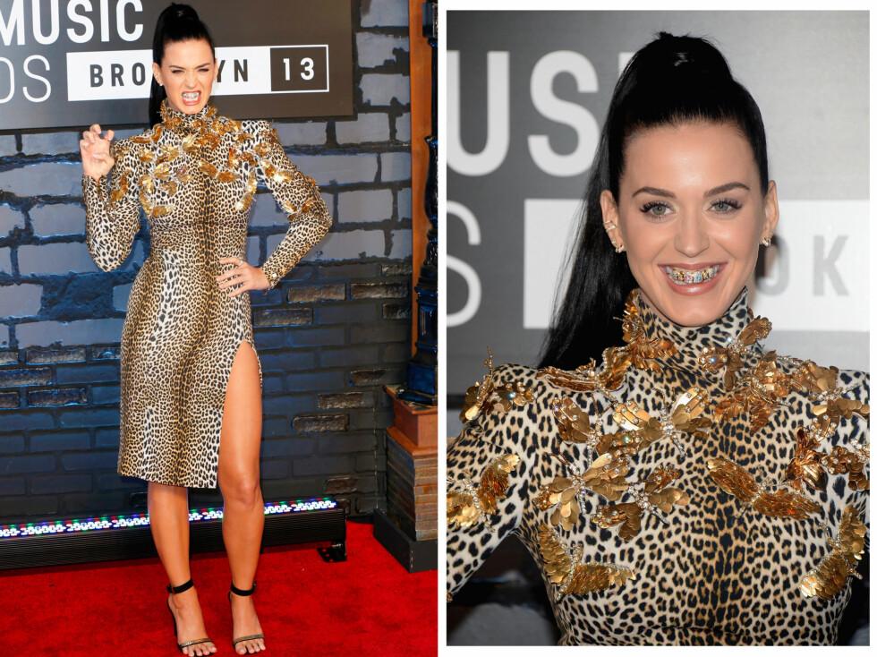 TAR EN MADONNA: Popstjernen Katy Perry lot seg inspirere av Madonna, og smykket tennene sine med gull på prisutdelingen til MTV.  Foto: All Over Press