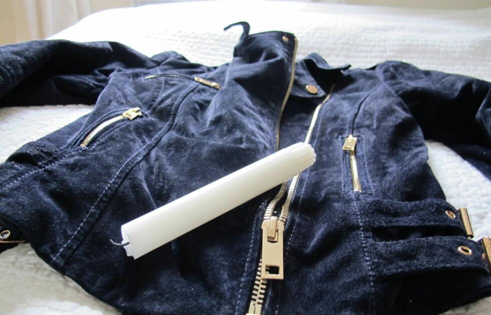 SMART SMØRING: Ved hjelp av et stearinlys får du vriene glidelåser på gli igjen. Foto: Stine Okkelmo