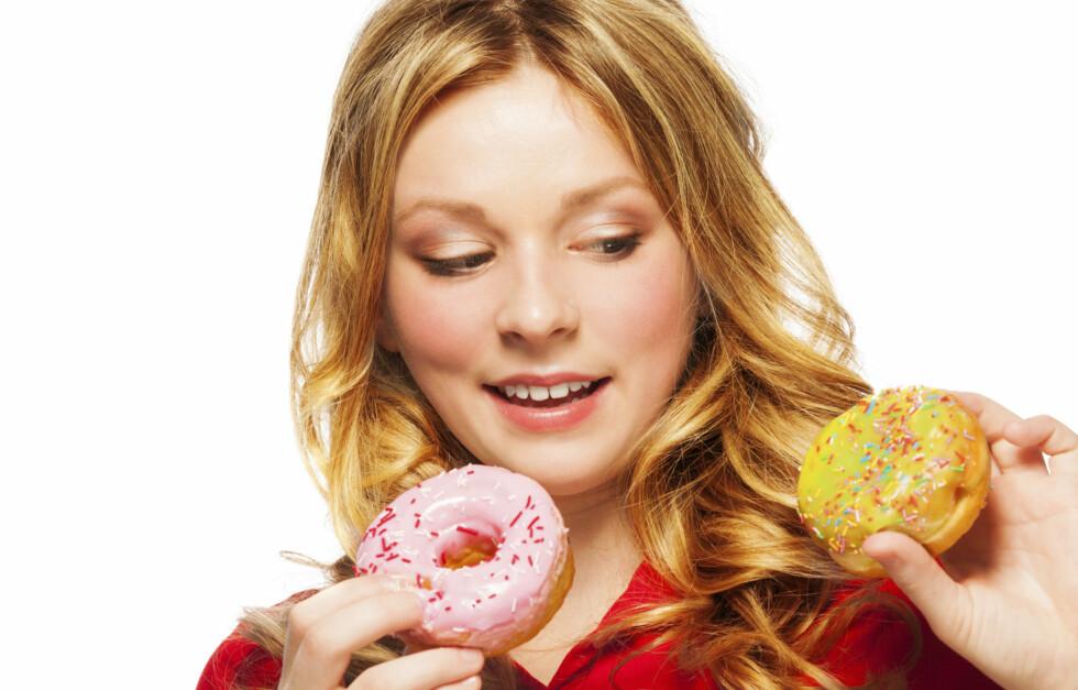 FRISTELSER: Klarer du ikke motstå spiselige fristelser? Du er ikke alene! Foto: Getty Images/iStockphoto