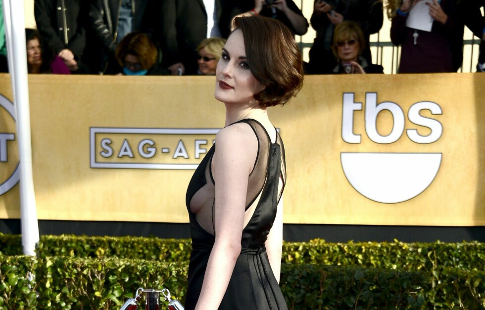DRISTIG: Downton Abbey-stjerne Michelle Dockery bar en av kveldens mer vågale kjoler, under søndagens Screen Actors Guild Awards i LA.  Foto: All Over Press