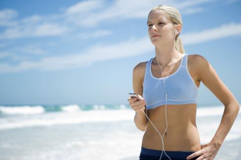 GODLYD: Bra musikk på øret gjør treningen lettere. Foto: Alix Minde / ZenShui