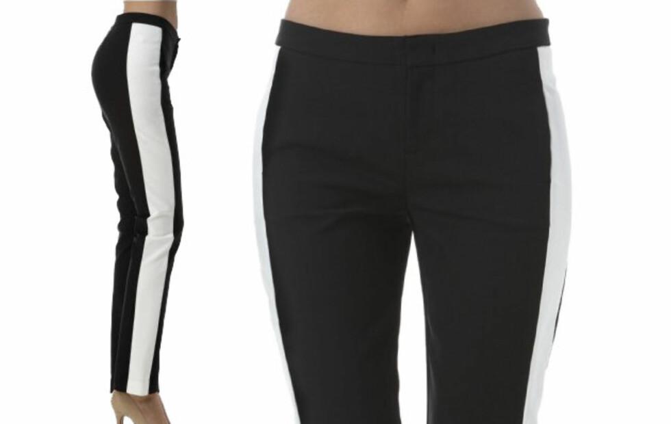 KONTRASTSTRIPE: Bukse med sidestripe er ikke bare supertrendy (kr.349/Gina Tricot). Den kan også gi illusjonen av lengre og slankere bein. Se flere kjøpetips i bildeviseren under. Foto: Produsenten