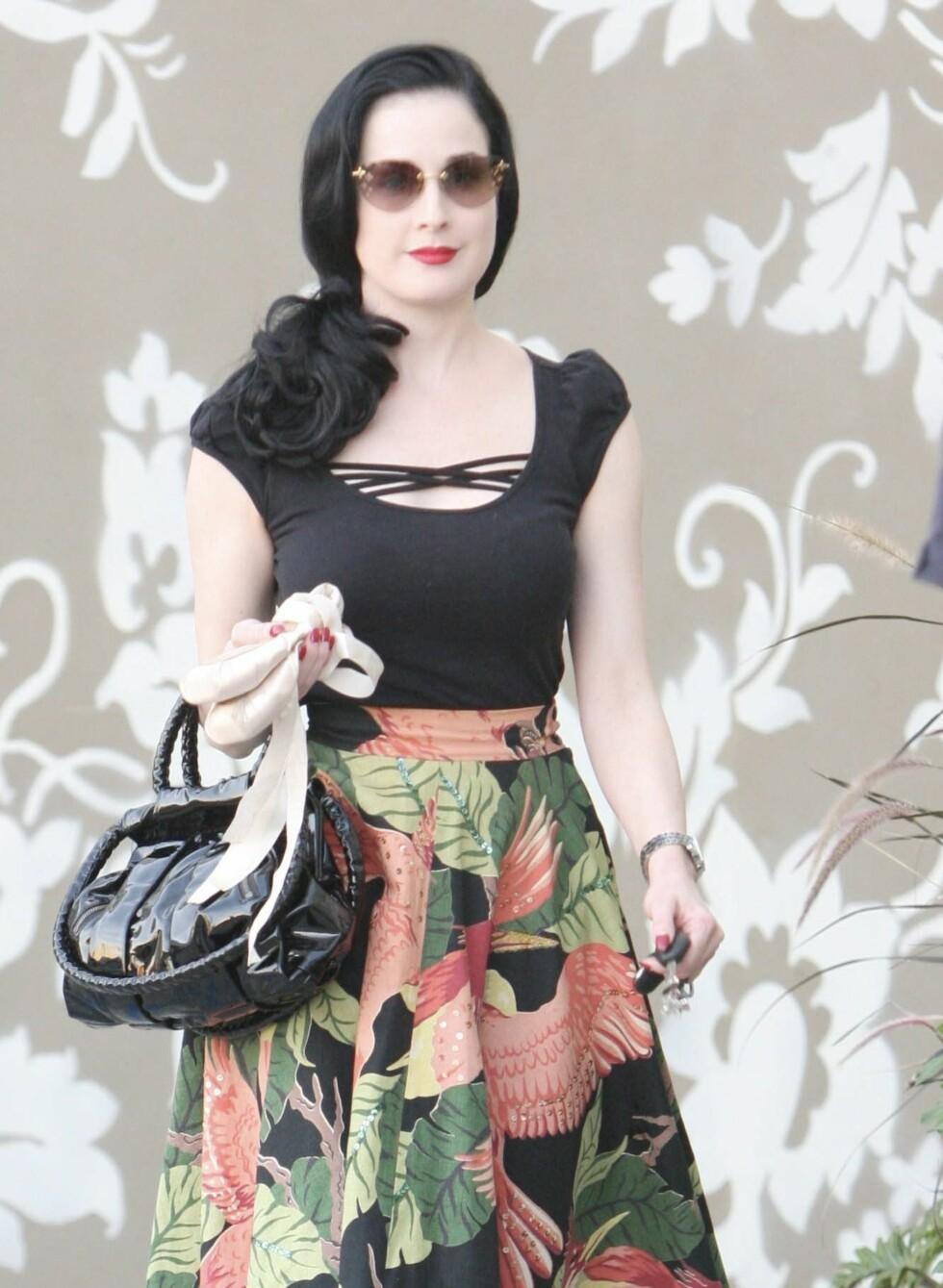 Burlesque-artist Dita Von Teese har gjort 40-tallslooken til sin. Her skal det være blekt og tandert!  Foto: All Over Press