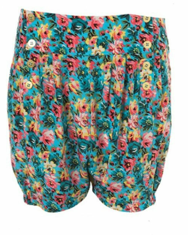Ingenting sier mer sommer enn denne shortsen (kr 300, Topshop).