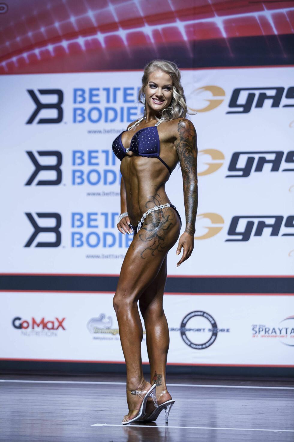 <strong>BIKINIFITNESS:</strong> Charlotte jobbet knallhardt frem til NM i bikinifitness i fjor høst. Hun endte på en syvendeplass i konkurransen. Foto: Jørgen Orlin