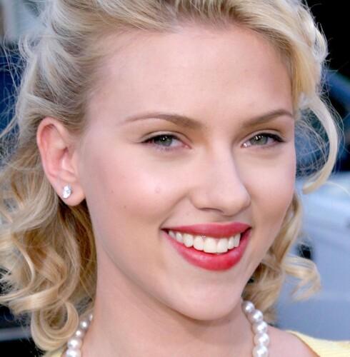FRUKTBAR: Fyldige røde lepper a la Scarlett Johansson er et tegn på fruktbarhet. Foto: All Over Press