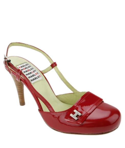 Ut-på-byen-skoeneGjør plass i bagasjen til ett par lekre sko med høye hæler som kan brukes på dager eller kvelder hvor du ikke skal gå så mye (Hearted Harlot, kr 1300).