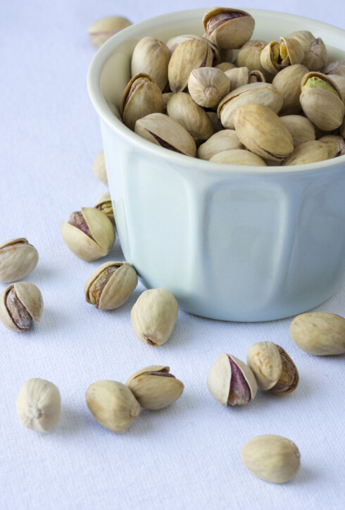Pistachio nuts in a white bowl  © Minna Waring / Lifestylepix / Retna UK CREDIT ALL USES DIGTAL FILE ONLY RESTRICTIONS: WORLDWIDE EXCL FRANCE/ ALL OVER PRESS ***Unless marked Model Released, all images that show people who can be recognized must be approved by All Over Press before usage. Please contact All Over Press for approval***