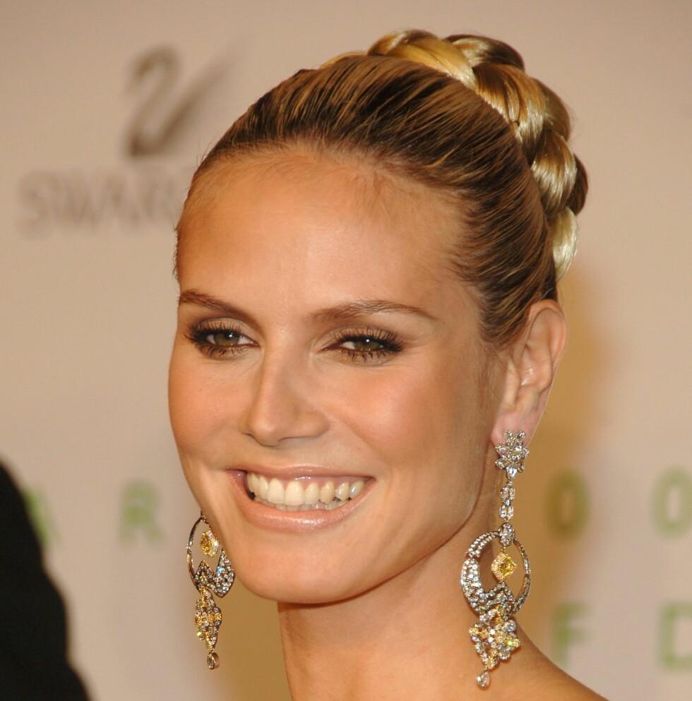 Gold is the king. Supermodellen Heidi Klum kan glise helt til banken.