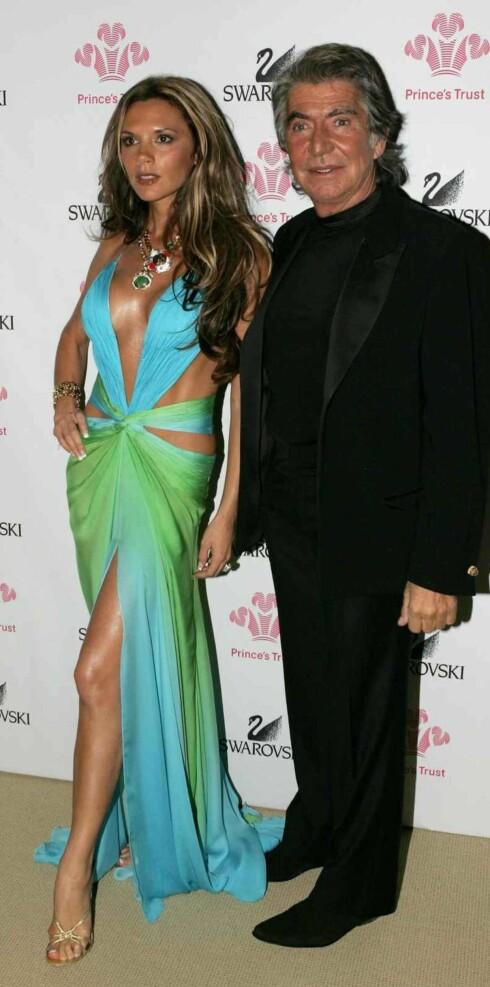 Victoria Beckhma sammen med designeren Roberto Cavalli.