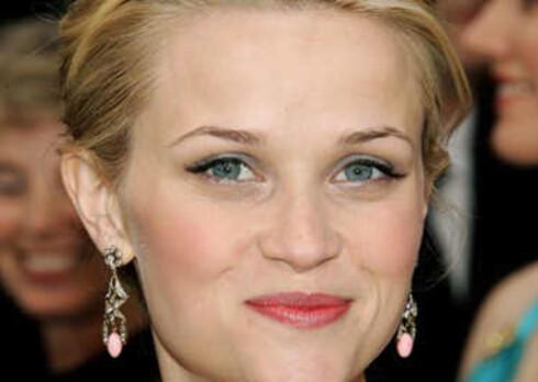 Reese Witherspoon smilte bredest av alle for sin Oscar som June Carter Cash i Walk The Line.