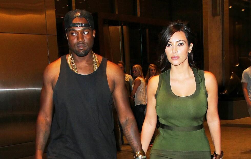 DYRT Å VÆRE KIM:Kim Kardashians skjønnhets- trening- og kostholdsregime koster henne godt over 620.000 kroner i året. Her er hun med kjæresten Kanye West.  Foto: All Over Press