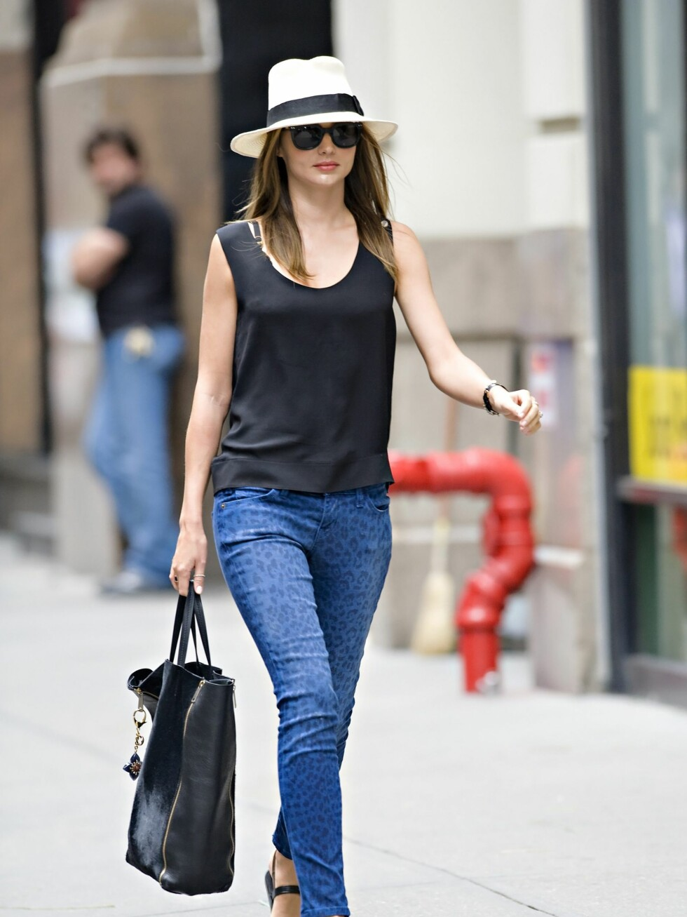 Miranda Kerr seen wearing bright blue leopard-print jeans and white fedora while returning from a trip to the spa in NYC.  Kerr was wearing bright blue leopard-print skinny trousers by Current/Elliot, paired with black strappy sandals, a black silk tank top, large dark retro sunglasses and a black leather tote bag.  Pictured: Miranda Kerr  Ref: SPL409977  260612   Picture by: Jason Webber / Splash News  Splash News and Pictures Los Angeles:310-821-2666 New York:212-619-2666 London:870-934-2666 photodesk@splashnews.com  *** Local Caption *** World Rights Foto: All Over Press