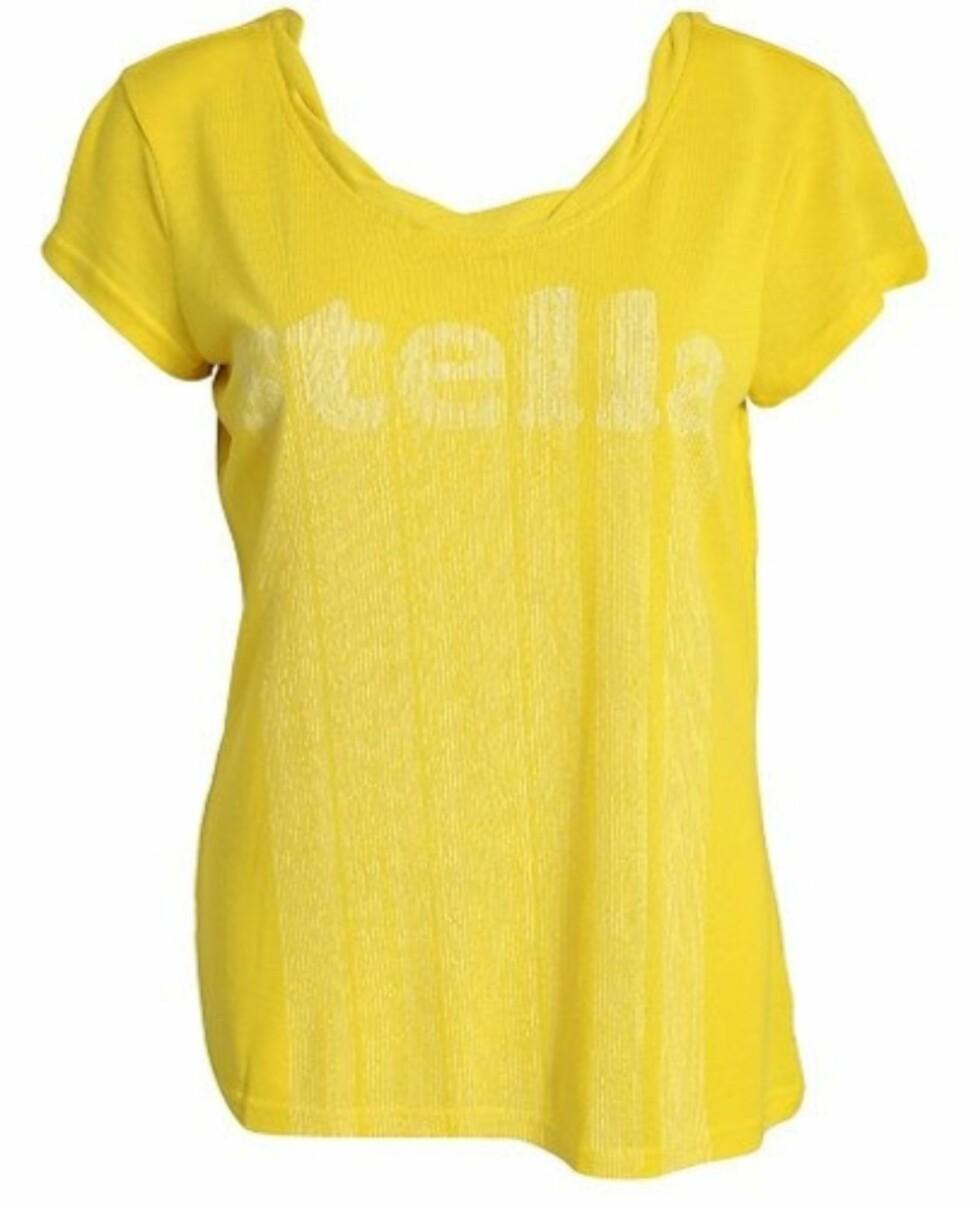 Knallgul trenings-tskjorte fra Adidas by Stella McCartney.  Laget av 64% lyocell og 34% resirkulert polyester.449 kroner fra Nelly.com.  Foto: Produsenten