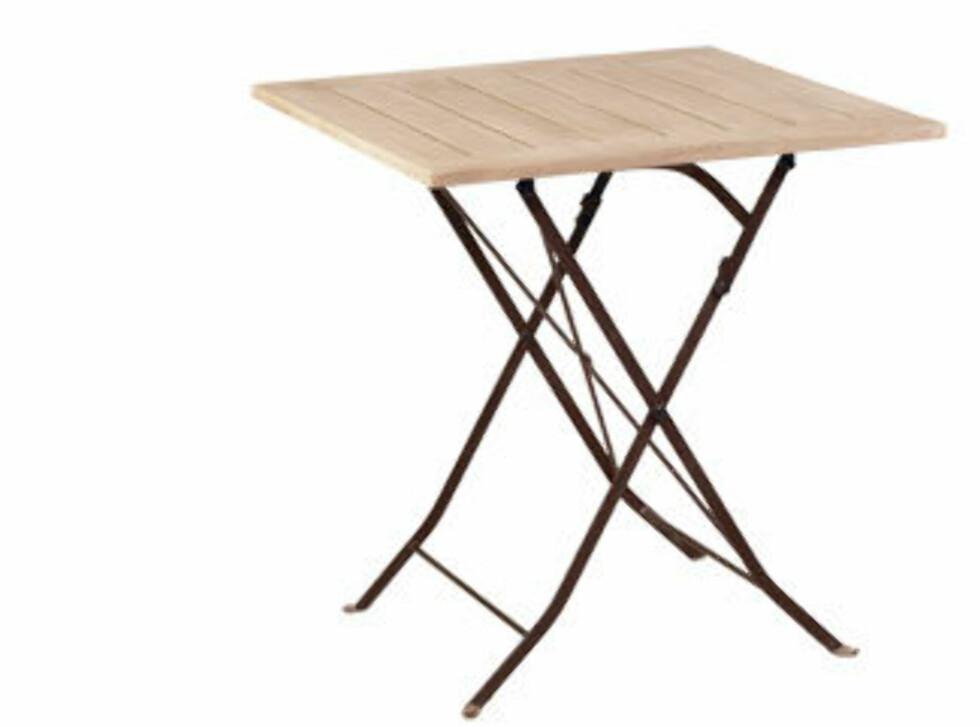 Stilig bord med treplate på toppen og stålbein (Kr. 1295, Skeidar). Foto: Ikea.no