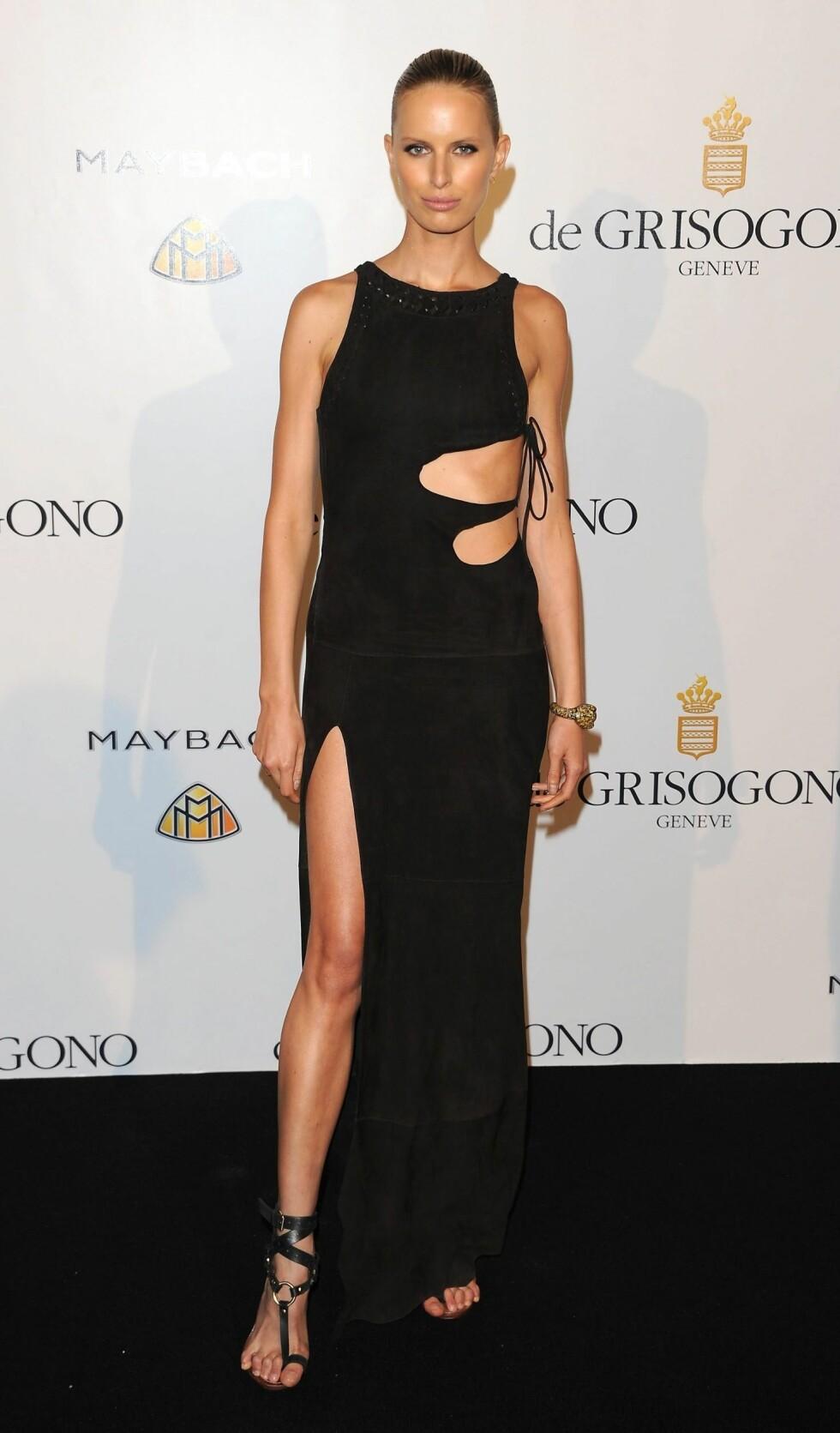 Supermodell Karolina Kurkova på de Grisogono Party i Cannes, i dristig Pucci-kreasjon med nakne partier og splitt. Foto: All Over Press
