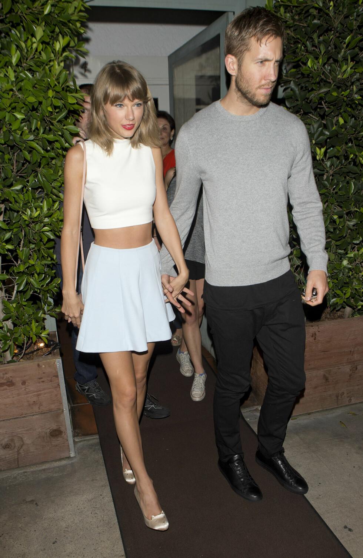 BRUDD: Etter bare 15 måneder tok forholdet mellom sanger Taylor Swift og DJ'en Calvin Harris slutt i juni. Foto: NTB Scanpix