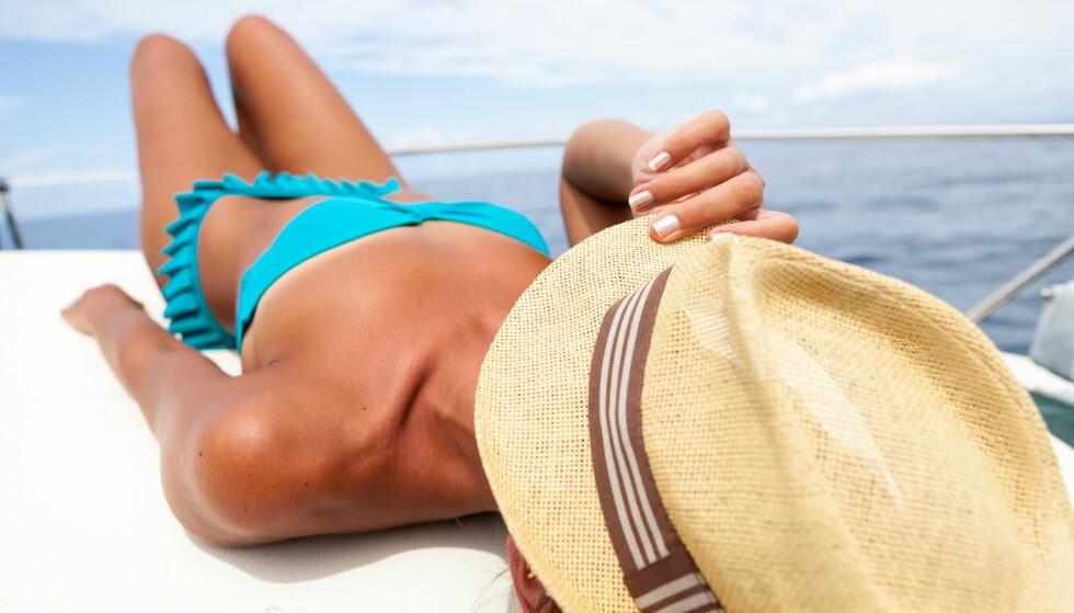 SOLE SEG: Studien tyder på at du kan bli avhengig av sol på samme måte som en mener en kan bli avhengig av trening. FOTO: NTB Scanpix