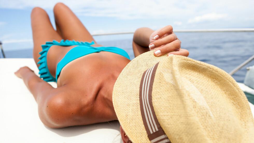 ATTRAKTIVT?: Vi spør ekspertene om vi faktisk er finere med brunfarge på kroppen.  Foto: francescopaoli - Fotolia